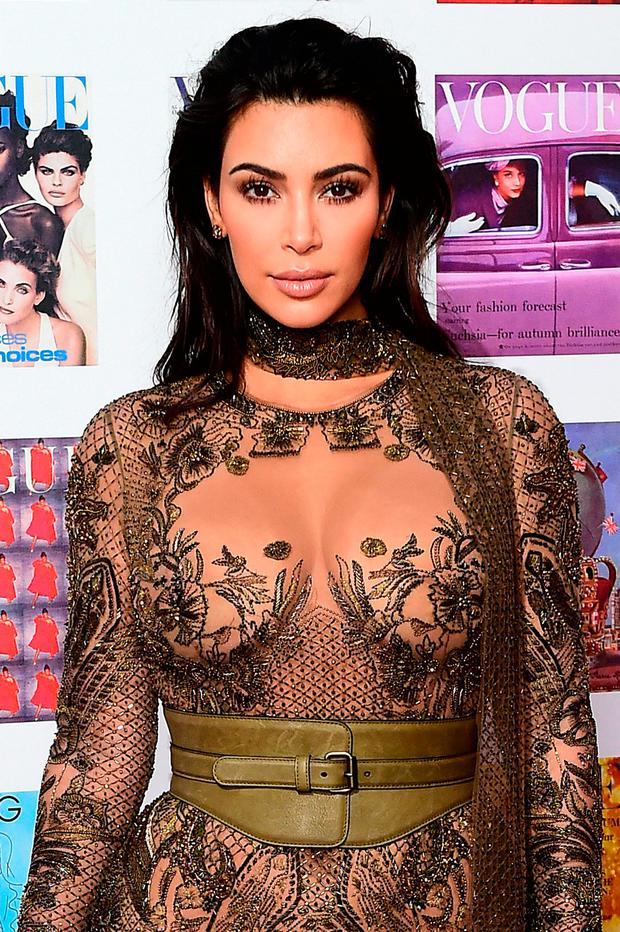 Flaunting: Kim Kardashian had millions of dollars worth of jewellery stolen from her when she was held at gunpoint during Paris Fashion Week last week Photo: Ian West/PA Wire