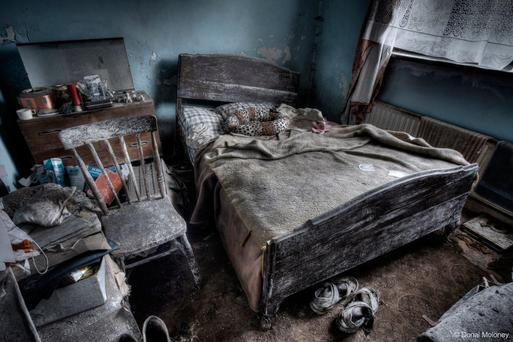 No country for old men: Paint peels off the wall in a bedroom in the rural home where three male family members once lived together before the last remaining son was taken into care Photo: Donal Moloney