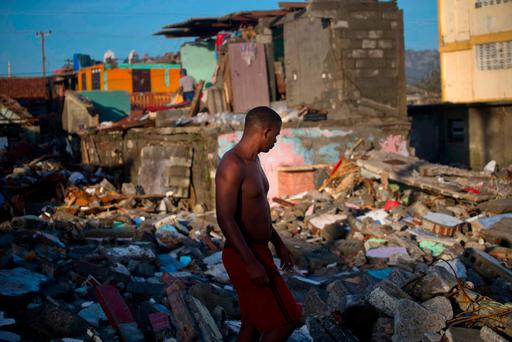 DEVASTATION: A man walks through the ruins of homes destroyed by Hurricane Matthew looking for personal belongings to salvage, in Baracoa, Cuba. Matthew hit Cuba's eastern tip last Tuesday, damaging hundreds of homes but there were no reports of deaths. Nearly 380,000 people were evacuated. Photo: AP Photo/Ramon Espinosa