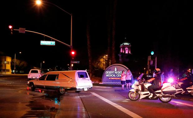 Hearses carry the bodies of two slain Palm Springs Police Department officers in a procession to the county coroner in Palm Springs, California, U.S. October 8, 2016. REUTERS/Sam Mircovich