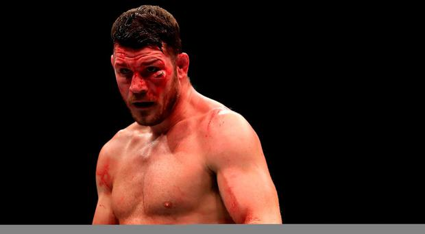 Michael Bisping during his bout against Dan Henderson in the Middleweight Championship of the World of UFC 204 at Manchester Arena. Pete Byrne/PA Wire