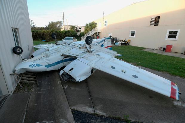 An airplane lies upside down at the Ormond Beach Municipal Airport in the aftermath of Hurricane Matthew in Ormond Beach, Florida, U.S. October 9, 2016. REUTERS/Phelan Ebenhack