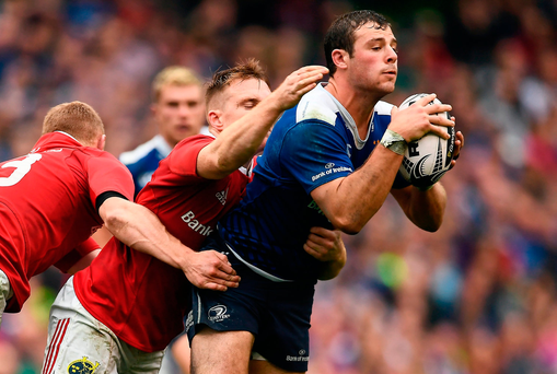 Leinster's Robbie Henshaw is tackled by Munster's Rory Scannell. Photo by Brendan Moran/Sportsfile
