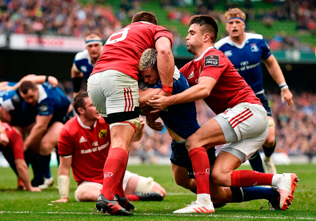 Luke McGrath of Leinster is held up short of the try line by CJ Stander, left, and Conor Murray of Munster. Photo by Brendan Moran/Sportsfile