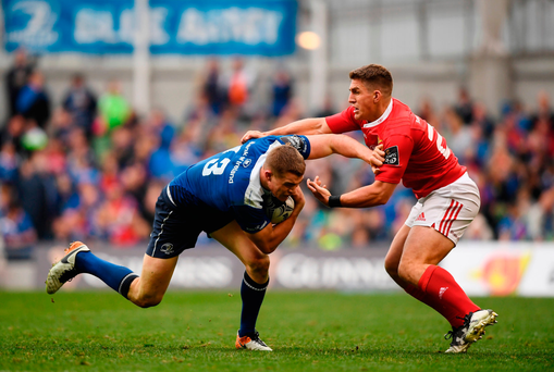 Garry Ringrose of Leinster is tackled by Ian Keatley of Munster. Photo by Stephen McCarthy/Sportsfile