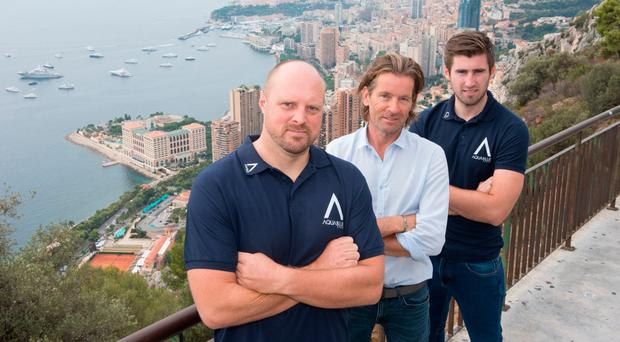 Rick Delaney (C) with Aqua Blue's director of performance operations Leigh Bryan (L) and general manager Stephen Moore
