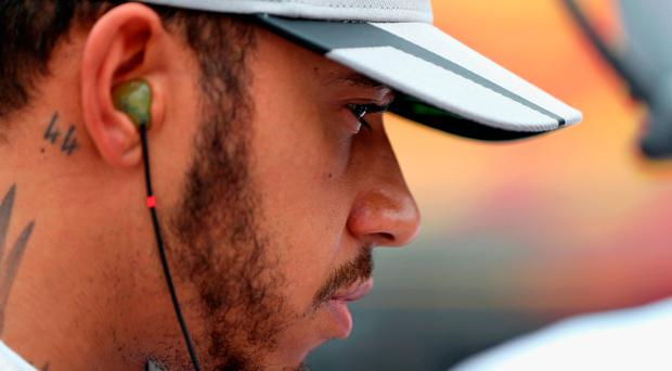 Lewis Hamilton all alone with his thoughts after a weekend to forget on Suzuka which left Nico Rosberg firmly in the driving seat. Photo by Mark Thompson/Getty Images