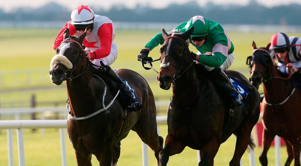 Bainne, with Oisin Orr up (right), on the way to winning the Stephen Quirke Memorial Apprentice Handicap at the Curragh yesterday. Photo credit: Brian Lawless/PA Wire