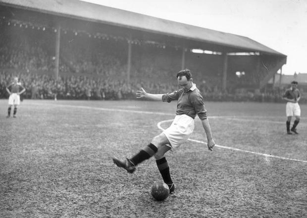 Manchester United and Ireland defender Jackie Carey, pictured before a match in 1947 (Photo by J. A. Hampton/Topical Press Agency/Getty Images)