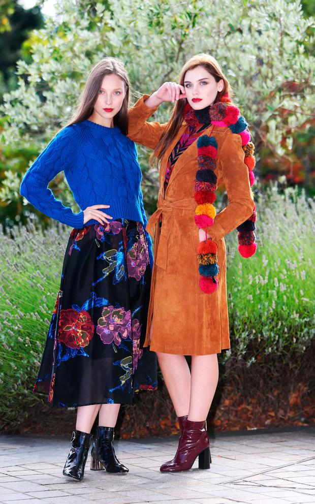 Model Anastacia in a DKNY blue jumper (€420) from Harvey Nichols, LK Bennett dress (€795) and River Island boots (€100); and Abby wears a House of Fraser Therapy suede coat (€220) and an Accessorize Pom Pom Scarf (€45.90).