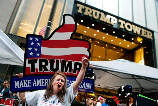 A supporter of Republican presidential nominee Donald Trump show their allegiance outside Trump Tower where he lives in Manhattan. REUTERS/Eduardo Munoz