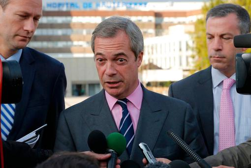 Mr Farage's comments echo the initial response of Mr Trump who dismissed the obscene language on a 2005 video tape as 'locker room banter'. REUTERS/Vincent Kessler