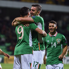 Shane Long celebrates after scoring his side's first goal with team mate Stephen Ward Photo by David Maher/Sportsfile