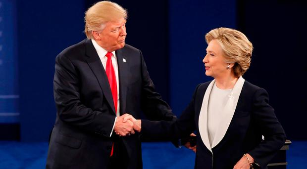 Republican U.S. presidential nominee Donald Trump and Democratic U.S. presidential nominee Hillary Clinton shake hands at the conclusion. REUTERS/Lucy Nicholson
