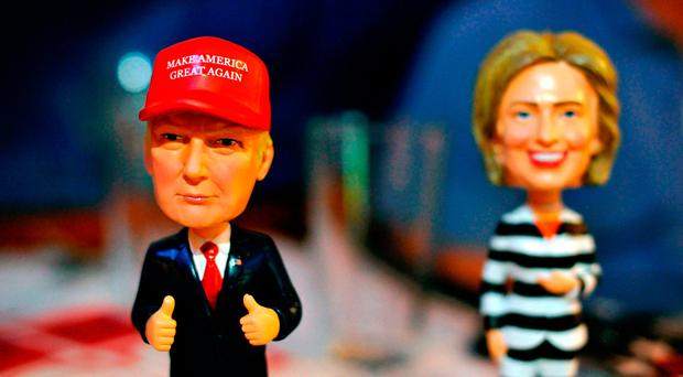 Bobble head figurines of Republican presidential nominee Donald Trump and Democratic presidential nominee Hillary Clinton greet Republican party supporters registering to watch a presidential debate watch party hosted by the Colorado Republican Party at Choppers Sports Grill in Denver, Colorado, Photo Jason Connolly/AFP/Getty Images