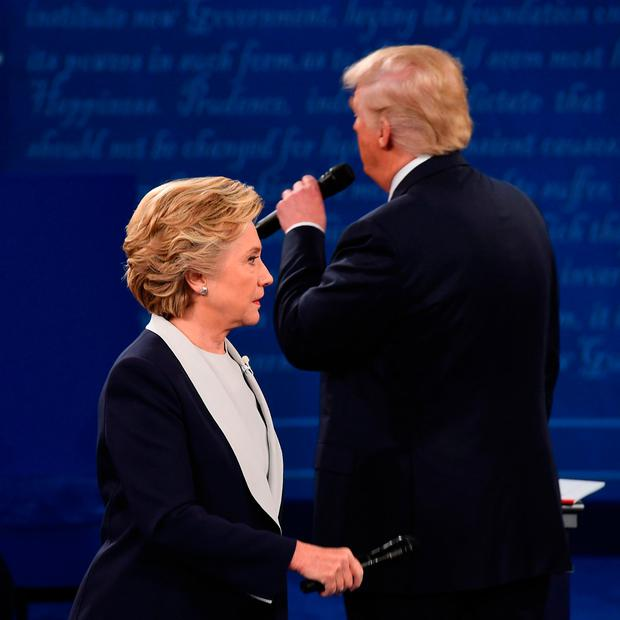US Democratic presidential candidate Hillary Clinton and US Republican presidential candidate Donald Trump debate during the second presidential debate Photo: Robyn BeckROBYN BECK/AFP/Getty Images