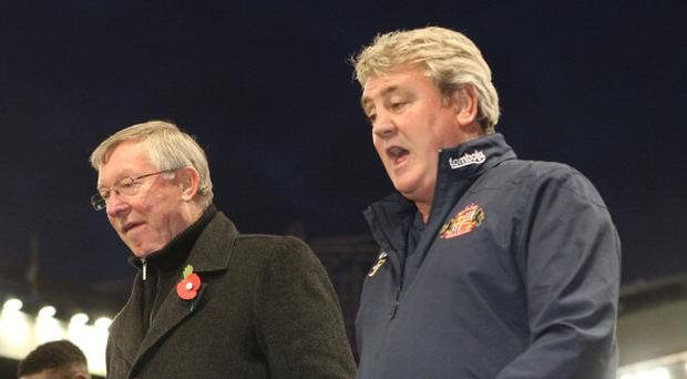 MANCHESTER, ENGLAND - NOVEMBER 05: Sir Alex Ferguson (L) of Manchester United and Steve Bruce of Sunderland walk off after the Barclays Premier League match between Manchester United and Sunderland at Old Trafford on November 5, 2011 in Manchester, England. (Photo by John Peters/Man Utd via Getty Images)