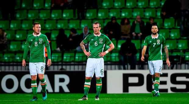James McCarthy, left, Glenn Whelan and Shane Duffy of Republic of Ireland look on after Igor Bugaev of Moldova scored his side's first goal during the FIFA World Cup Group D Qualifier match between Moldova and Republic of Ireland at Stadionul Zimbru in Chisinau, Moldova. Photo by David Maher/Sportsfile
