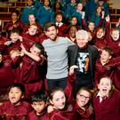 Adam Clayton, Eoghan McDermott and children from St.James's Primary and Secondary school at St. Patrick's University Hospital, attempting to set the Guinness World Record for the World's Largest Mindfulness Lesson to mark World Mental Health Awareness Day. Pic: Marc O'Sullivan