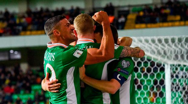 James McClean of Republic of Ireland, centre, celebrates after scoring his side's second goal with team mates Jonathan Walters, left, and Seamus Colman during the FIFA World Cup Group D Qualifier match between Moldova and Republic of Ireland at Stadionul Zimbru in Chisinau, Moldova. Photo by David Maher/Sportsfile