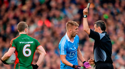 Referee Maurice Deegan shows Jonny Cooper a black card in the All-Ireland SFC final replay Photo: Piaras Ó Mídheach/Sportsfile