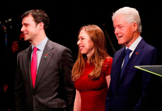 Hillary Clinton's supporters included husband Bill Clinton, daughter Chelsea and her husband Marc Mezvinsky. (Photo by Rick Wilking-Pool/Getty Images)