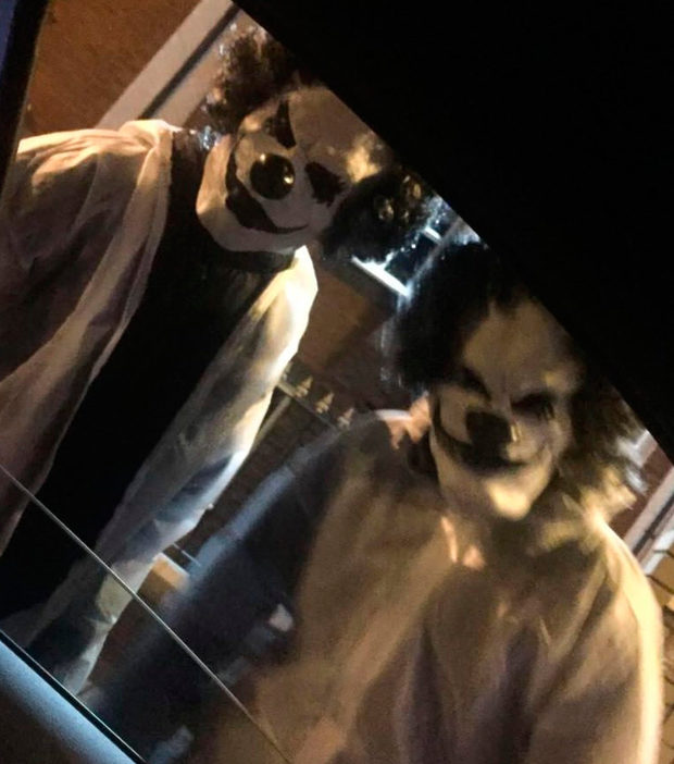Kurtis Mulvaney managed to take this picture of the 'clowns' who approached cars in Manchester