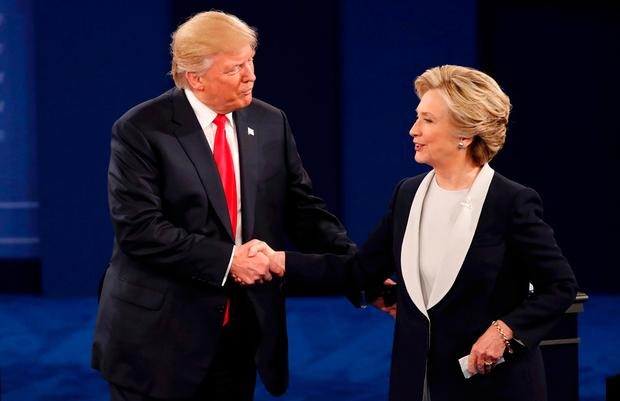 Donald Trump and Hillary Clinton shake hands at the end of their presidential town hall debate at Washington University in St Louis, Missouri. REUTERS/Lucy Nicholson