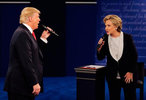 Republican presidential nominee Donald Trump and Democratic presidential nominee Hillary Clinton speak during the second presidential debate at Washington University in St. Louis. AP Photo/John Locher