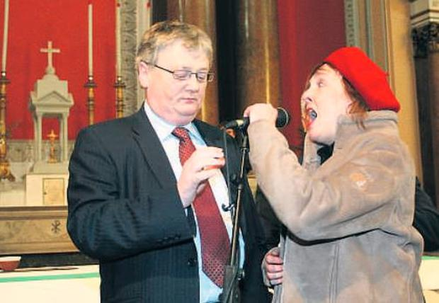 Fianna Fail junior health minister John Maloney as agry pensioners turned out in their droves