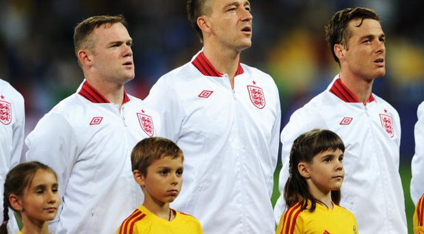KIEV, UKRAINE - JUNE 24: Wayne Rooney, John Terry and Scott Parker of England line up prior to the UEFA EURO 2012 quarter final match between England and Italy at The Olympic Stadium on June 24, 2012 in Kiev, Ukraine. (Photo by Michael Regan - The FA/The FA via Getty Images)