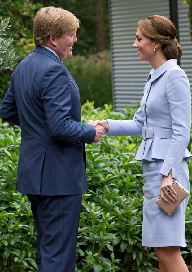 Britain's Kate, the Duchess of Cambridge, is greeted by Dutch King Willem-Alexander upon her arrival in The Hague, Netherlands