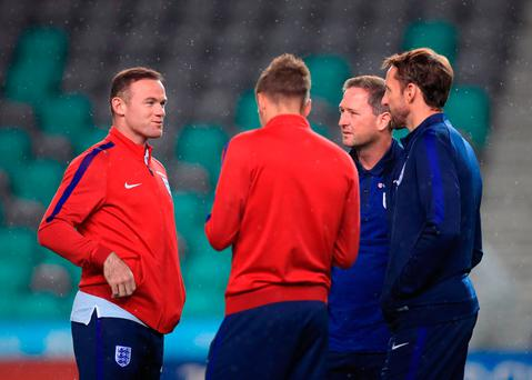 England's Wayne Rooney (left), Jamie Vardy (centre) and caretaker manager Gareth Southgate (right)
