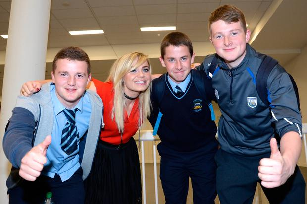 Broadcaster Anna Geary with Lee Keane, Aaron Gleeson and David Guiry from Comeragh College, Carrick-on-Suir, at Zeminar 2016 at the RDS. Pic: Justin Farrelly.