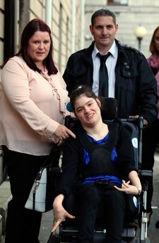 Nadine Wilkin with her parents after settlement was reached. Pic: Courts Collins