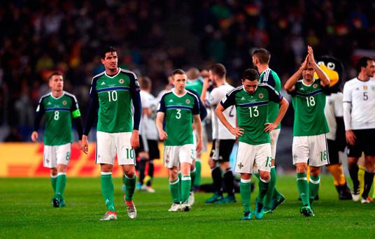 Northern Ireland's Kyle Lafferty (left), Corry Evans and their team-mates appear dejected