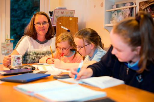 Sam Walsh with her children at her home in Kilmacud, Co Dublin. Photo: Mark Condren