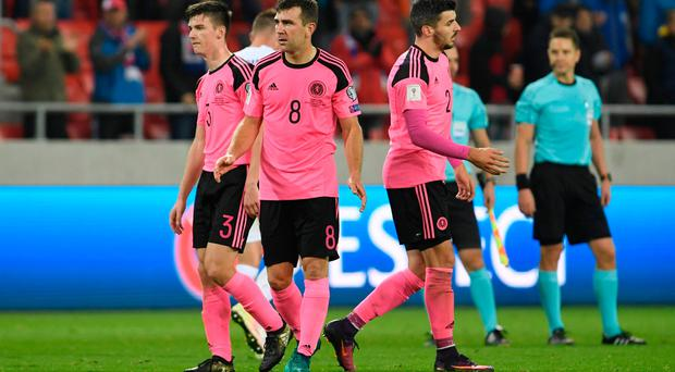 Scotland's Kieran Tierney, James McArthur and Callum Paterson look dejected after the game