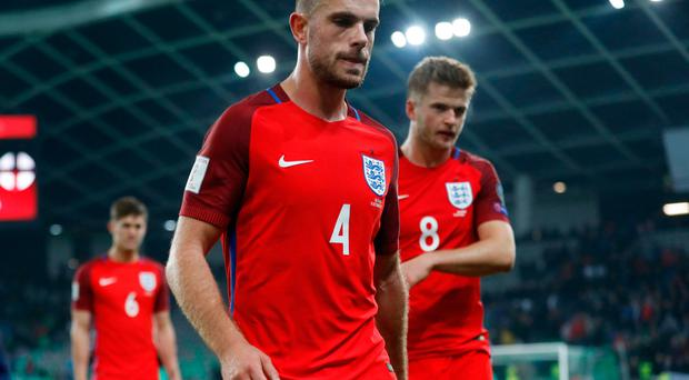 England's Jordan Henderson looks dejected at the end of the match