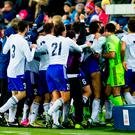 The San Marino team celebrate after scoring a goal