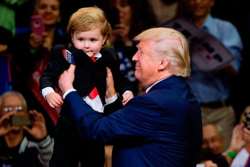 Donald Trump holds as child dressed as him during a rally at Mohegan Sun Arena in Wilkes-Barre, Pennsylvania. Photo: Getty Images