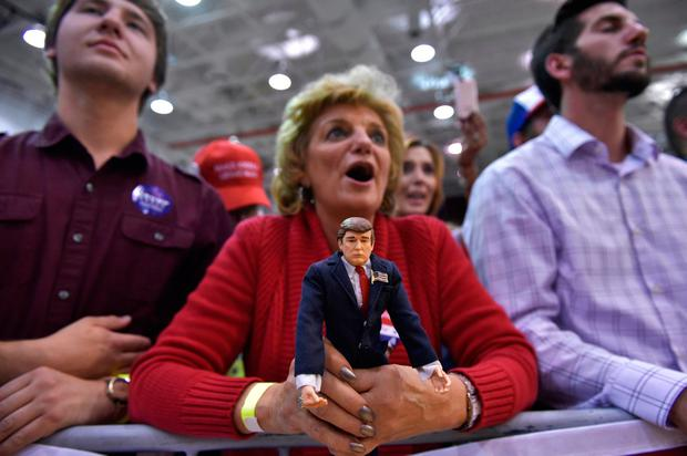 A supporter clutches a Donald Trump doll while waiting for his arrival in Ambridge, Pennsylvania. Photo: Getty Images