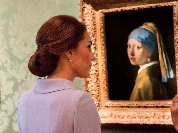 The Duchess of Cambridge views Girl with a Pearl Earring by Johannes Vermeer at the Mauritshuis in The Hague where she visited an exhibition of 22 picture by Dutch artists loaned to the art gallery from the Royal Collection.