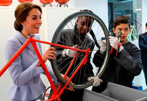 The Duchess of Cambridge meets pupils in a bike building class during a visit to the De Bouwkeet Work Space in Rotterdam, the Netherlands.