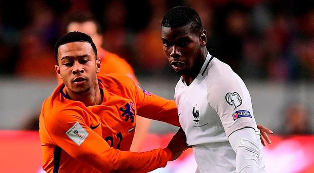 Manchester United team mates Paul Pogba and Memphis Depay during the FIFA World Cup 2018 qualifying football match between Netherlands and France on Monday