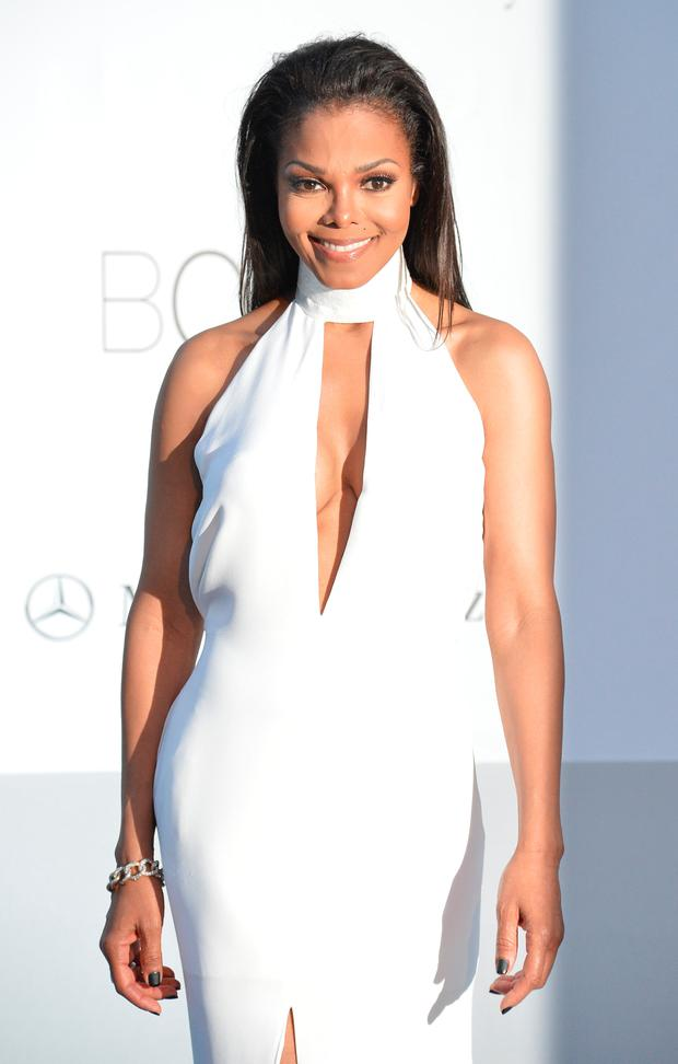 US singer Janet Jackson poses as she arrives to attend the 2012 amfAR's Cinema Against Aids on May 24, 2012