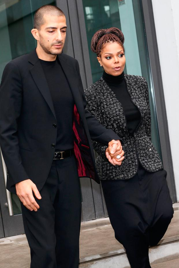 Wissam al Mana and Janet Jackson attend the Giorgio Armani fashion show as part of Milan Fashion Week Womenswear Fall/Winter 2013/14 on February 25, 2014 in Milan, Italy. (Photo by Vittorio Zunino Celotto/Getty Images)