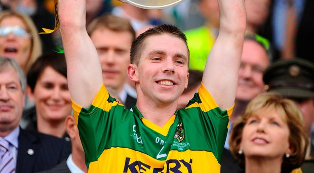 Kerry's Marc O Se lifts the Sam Maguire cup in 2009. Photo: Stephen McCarthy / Sportsfile