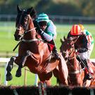 Rolling Revenge ridden by Mark Walsh (left) clears the last on the way to winning at Punchestown Photo: Brian Lawless/PA Wire