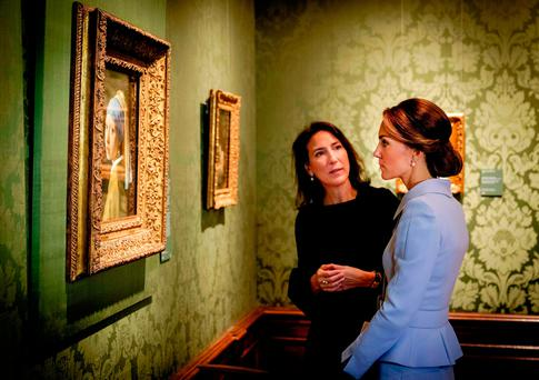 Kate Middleton, the Duchess of Cambridge, views the famous Dutch 17th century painting 'Girl with a Pearl Earring' by Johannes Vermeer during her visit to the Mauritshuis Museum in The Hague. She was making her first solo official trip abroad as part of a British charm offensive after the Brexit vote. AFP/Getty Images